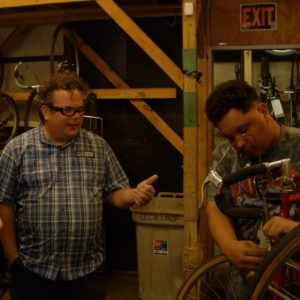 Award volunteer learns #worldready skills at West Town Bikes in Chicago, IL.